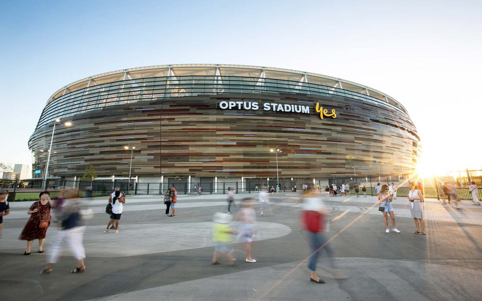Optus Stadium building walkway with sunset.